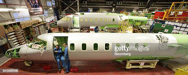 Bombardier aircraft electricians work on a Learjet 40 XR aircraft on the production line in Belfast Northern Ireland on Monday Jan 21 2008 Bombardier...