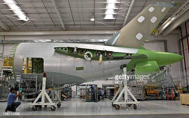 Bombardier employees work on an aft fuselage at the company's plant in Queretaro Mexico May 5 2012 Even as pockets of modernity emerge in Mexico half...