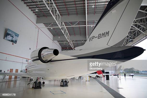 A Bombardier Inc Challenger 605 stands inside Bombardier's aircraft maintenance facility at Seletar Aerospace Park in Singapore on Tuesday Feb 11...