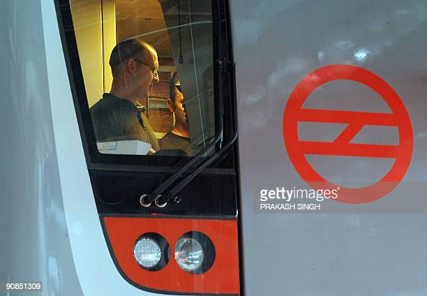 Bombardier technicians check the driver's cabin of a Delhi Metro new broad gauge train manufactured by Bombardier during a preview in New Delhi on...