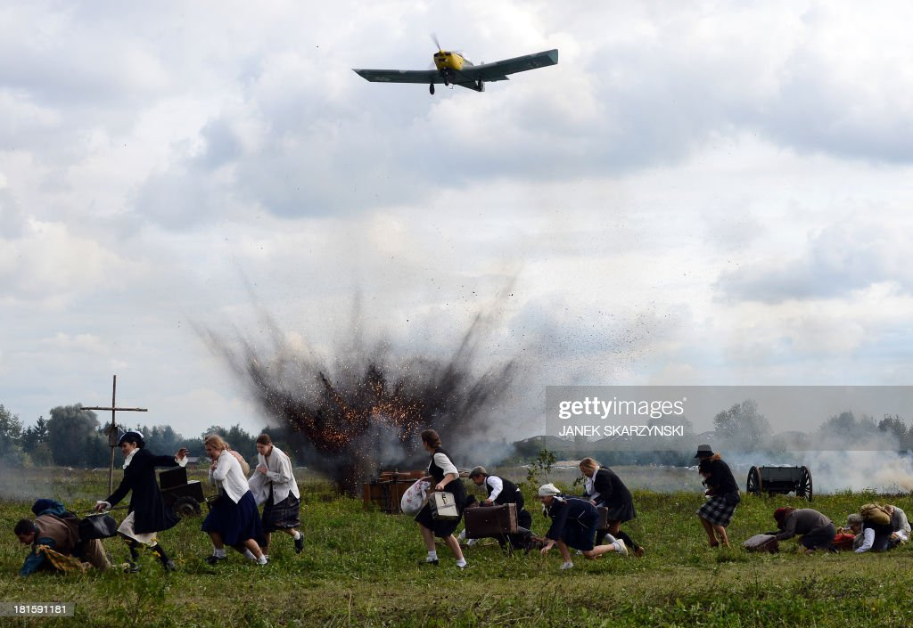 Bombarding of civilians during the reconstruction of the battle at the begining of WWII on September 19,1939 in the outskirts of Warsaw between Polish and German armies with last cavalry charge on September 22, 2013 in Lomianki.