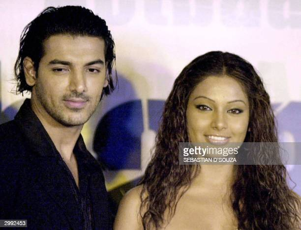 In this picture taken 18 November 2003 Indian actors Bipasha Basu and John Abraham pose during the release of the soundtrack of the movie 'Aetbaar'...