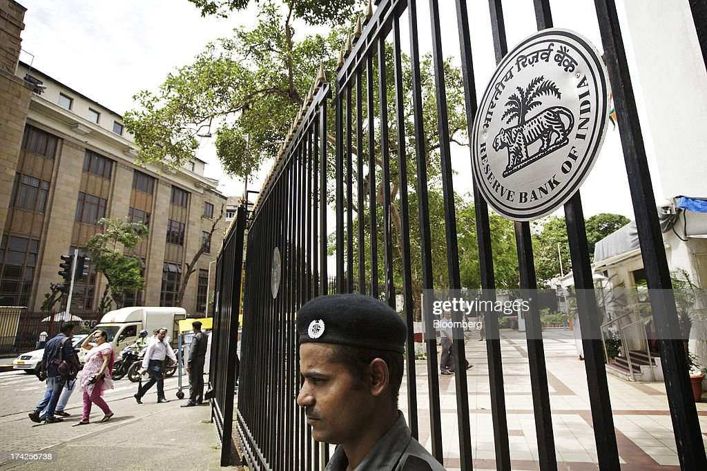 A Bombay Intelligence Security stands guard beside Reserve Bank of India signage outside the central bank's headquarters in Mumbai India on Monday...