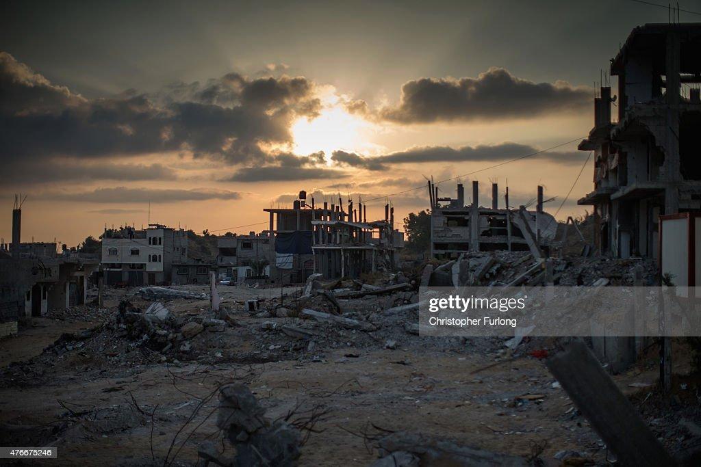 Bombed buildings scar the landscape where families still live amongst the rubble of Gaza on June 11 Gaza City Gaza The devastation across Gaza can...