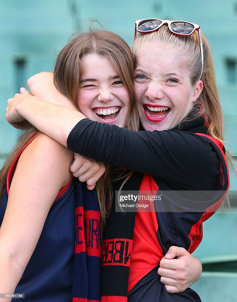 A Bomber and a Demon fan show their support during the round two AFL match between the Essendon Bombers and the Melbourne Demons at Melbourne Cricket Ground on April 6, 2013 in Melbourne, Australia.