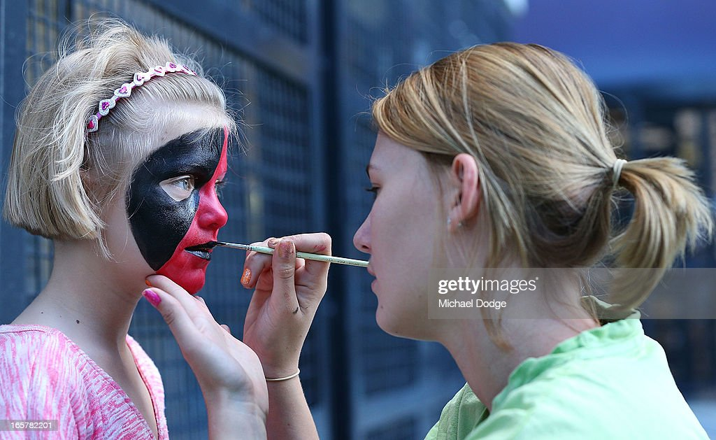 A Bomber fan gets her face painted during the round two AFL match between the Essendon Bombers and the Melbourne Demons at Melbourne Cricket Ground on April 6, 2013 in Melbourne, Australia.