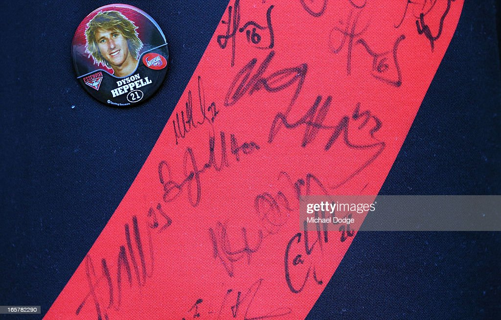 A Bomber fan wears a jumper with autographs on it during the round two AFL match between the Essendon Bombers and the Melbourne Demons at Melbourne Cricket Ground on April 6, 2013 in Melbourne, Australia.