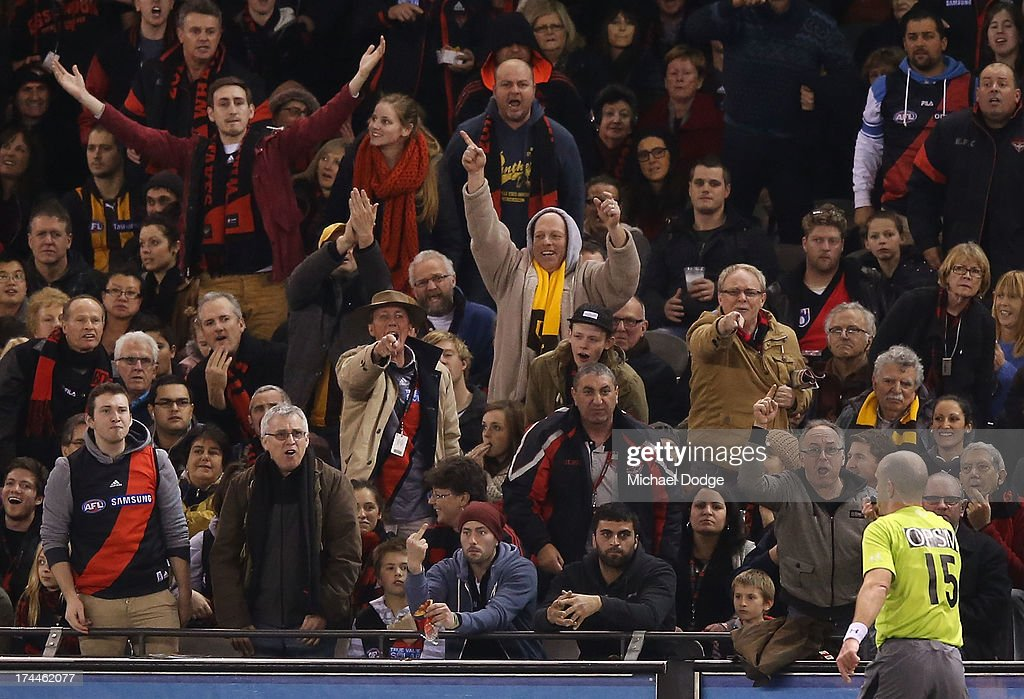 Bomber fans react when the umpire awarded a free kick to Hawthorn during the round 18 AFL match between the Essendon Bombers and the Hawthorn Hawks at Etihad Stadium on July 26, 2013 in Melbourne, Australia.