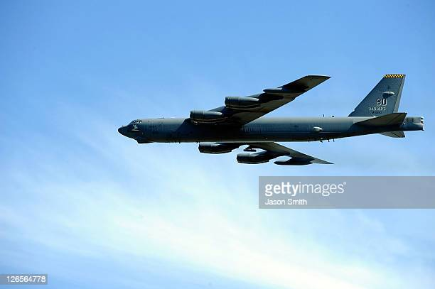B52 bomber flys over the track during prerace activities prior to the start of the Sylvania 300 at the New Hampshire Motor Speedway at New Hampshire...