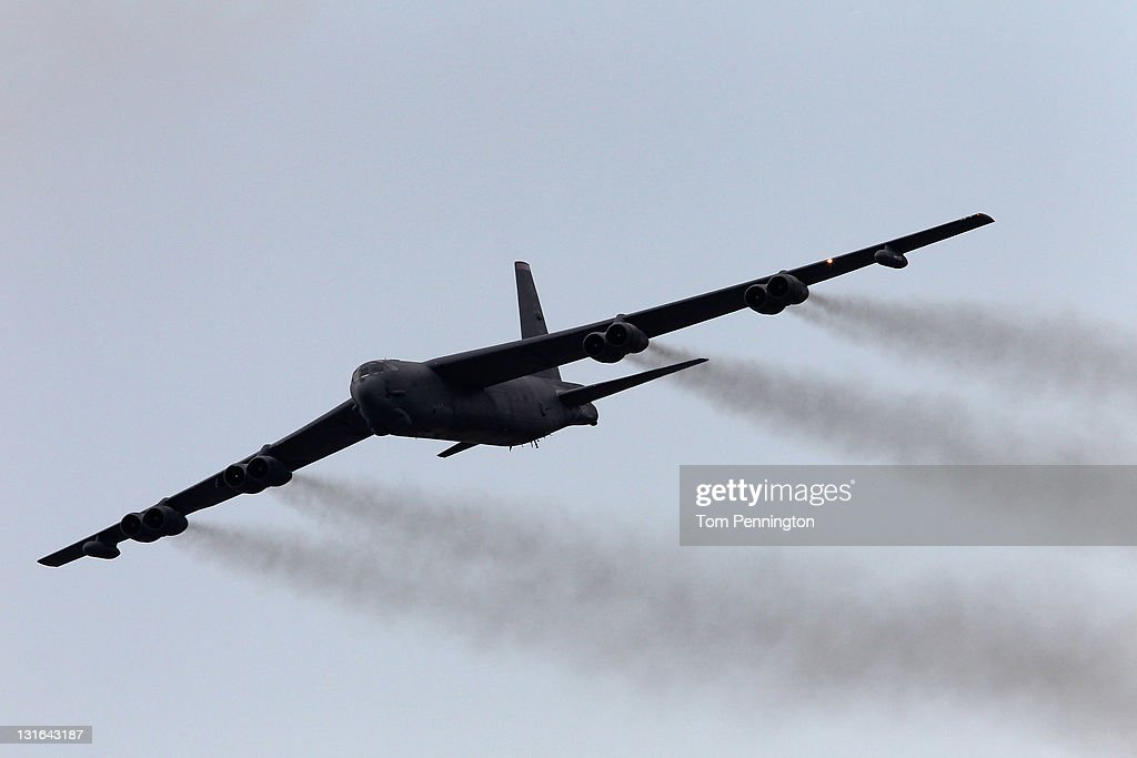 B52 bomber flys over the track during prerace activities prior to the start of the NASCAR Sprint Cup Series AAA Texas 500 at Texas Motor Speedway on...