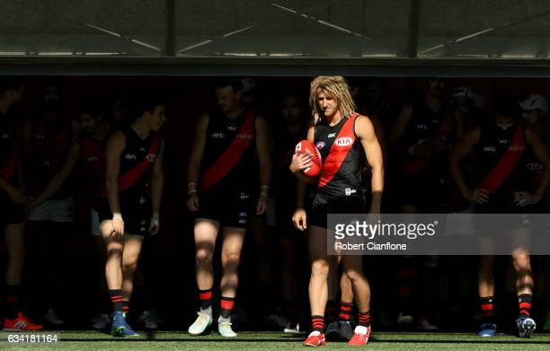 Bombers captain Dyson Heppell leads the team out during the Essendon Bombers AFL intraclub match at True Value Solar Centre on February 8 2017 in...