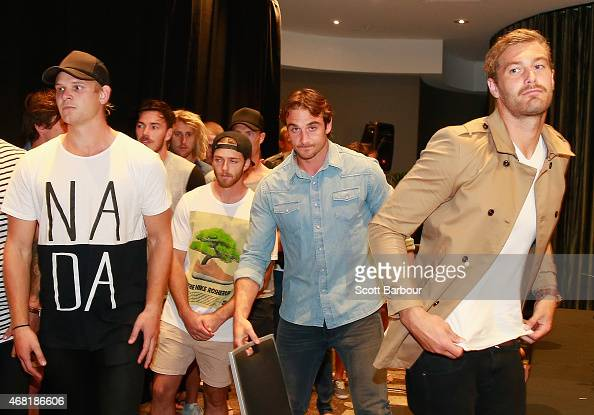 Bombers captain Jobe Watson flanked by his teammates including Michael Hurley Travis Colyer and Tom Bellchambers leave after speaking to the media at...