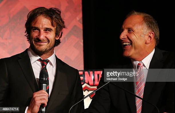 Bombers captain Jobe Watson talks with is father and Bombers legend Tim Watson looks on during the Essendon Bombers 2015 AFL season launch at...