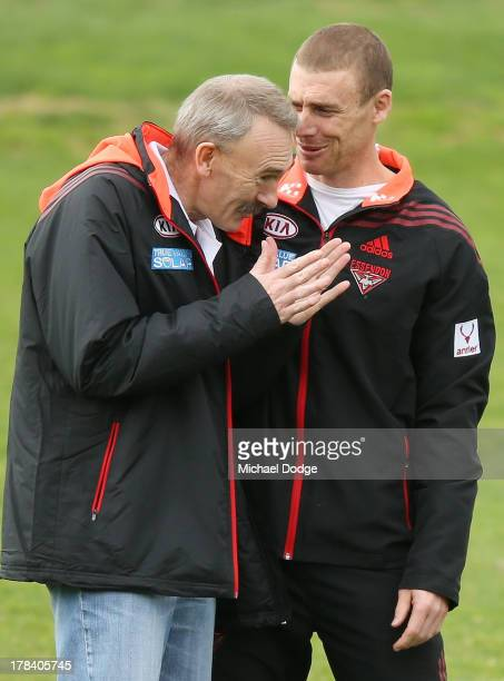 Bombers CEO Ray Gunston gestures to interim senior coach Simon Goodwin during an Essendon Bombers training session at Windy Hill on August 30 2013 in...