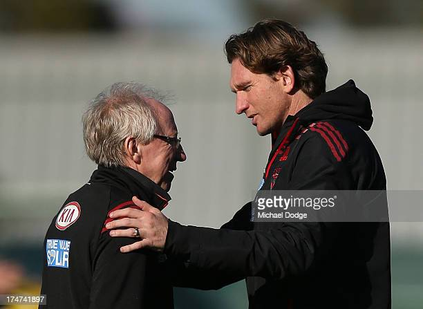 Bombers coach James Hird embraces Dr Bruce Reid at Essendon Bombers training at Windy Hill on July 29 2013 in Melbourne Australia