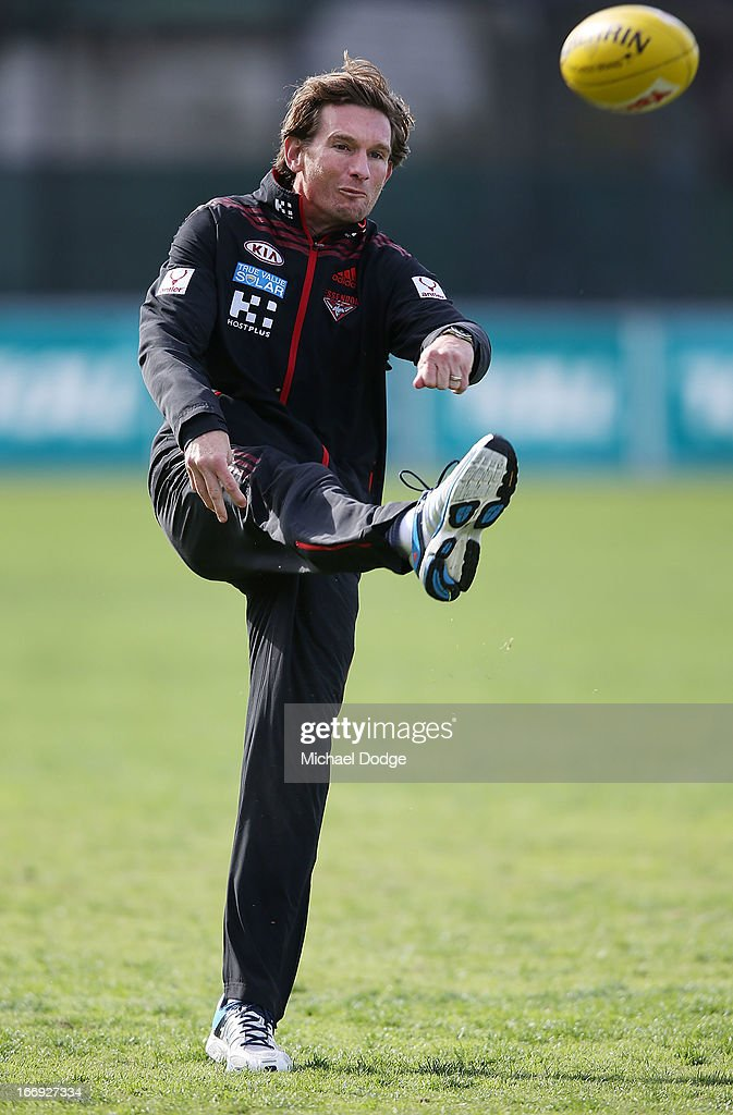 Bombers coach James Hird kicks the ball during an Essendon Bombers AFL training session at Windy Hill on April 19, 2013 in Melbourne, Australia.
