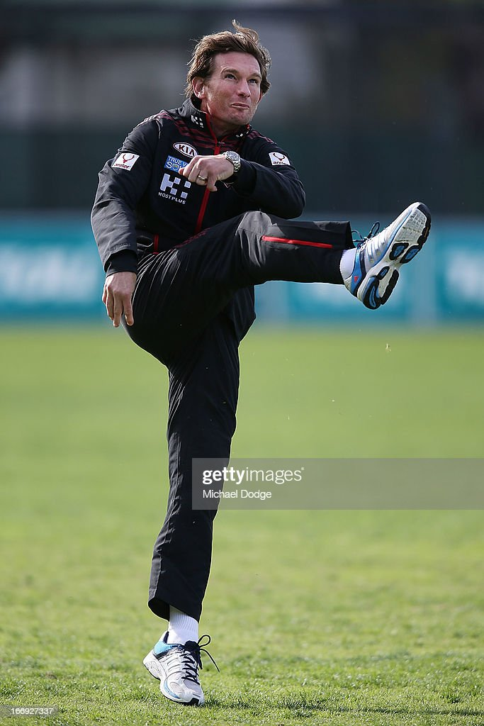 Bombers coach <a gi-track='captionPersonalityLinkClicked' href=/galleries/search?phrase=James+Hird&family=editorial&specificpeople=201975 ng-click='$event.stopPropagation()'>James Hird</a> kicks the ball during an Essendon Bombers AFL training session at Windy Hill on April 19, 2013 in Melbourne, Australia.