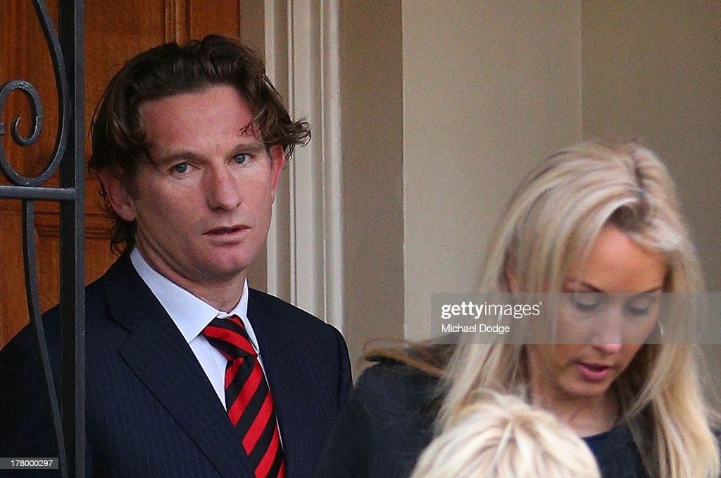 Bombers coach James Hird leaves his home in Toorak with wife Tania Hird for the Essendon Bombers AFL Commission Hearing at AFL House on August 27...