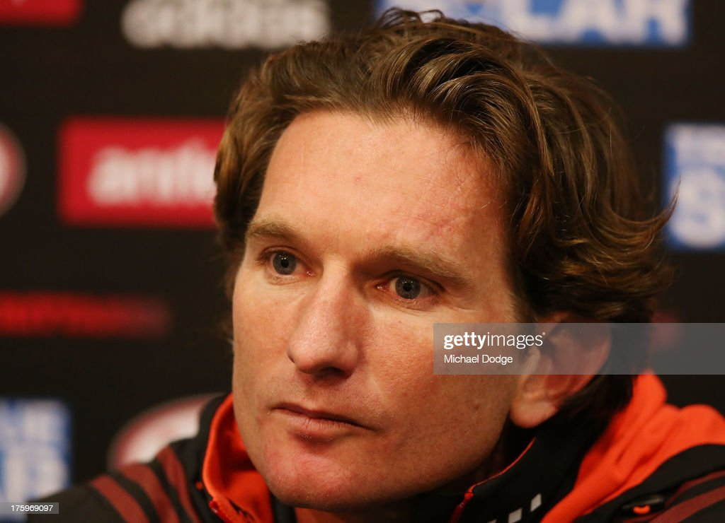 Bombers coach <a gi-track='captionPersonalityLinkClicked' href=/galleries/search?phrase=James+Hird&family=editorial&specificpeople=201975 ng-click='$event.stopPropagation()'>James Hird</a> looks ahead during his post match interview after the round 20 AFL match between the Essendon Bombers and the West Coast Eagles at Etihad Stadium on August 11, 2013 in Melbourne, Australia.
