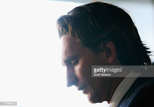 Bombers coach James Hird looks down as he speaks to the media during an Essendon Bombers AFL press conference at The Olsen Hotel on August 21 2013 in...