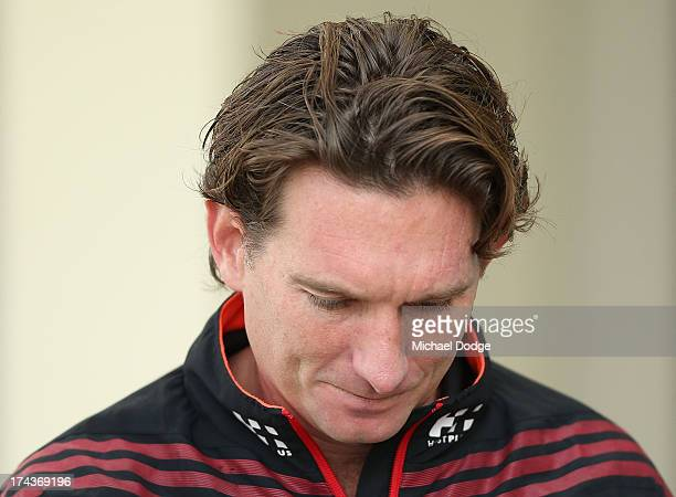 Bombers coach James Hird looks down before he speaks to the media during an Essendon Bombers AFL recovery session at the St Kilda Sea Baths on July...