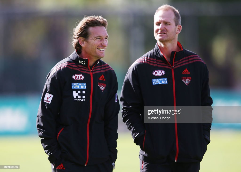 Bombers coach James Hird (L) reacts next to assistant coach Sean Wellman during an Essendon Bombers AFL training session at Windy Hill on April 19, 2013 in Melbourne, Australia.