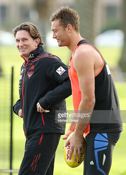 Bombers coach James Hird reacts with Tom Bellchambers during an Essendon Bombers AFL recovery session at the St Kilda Sea Baths on July 25 2013 in...