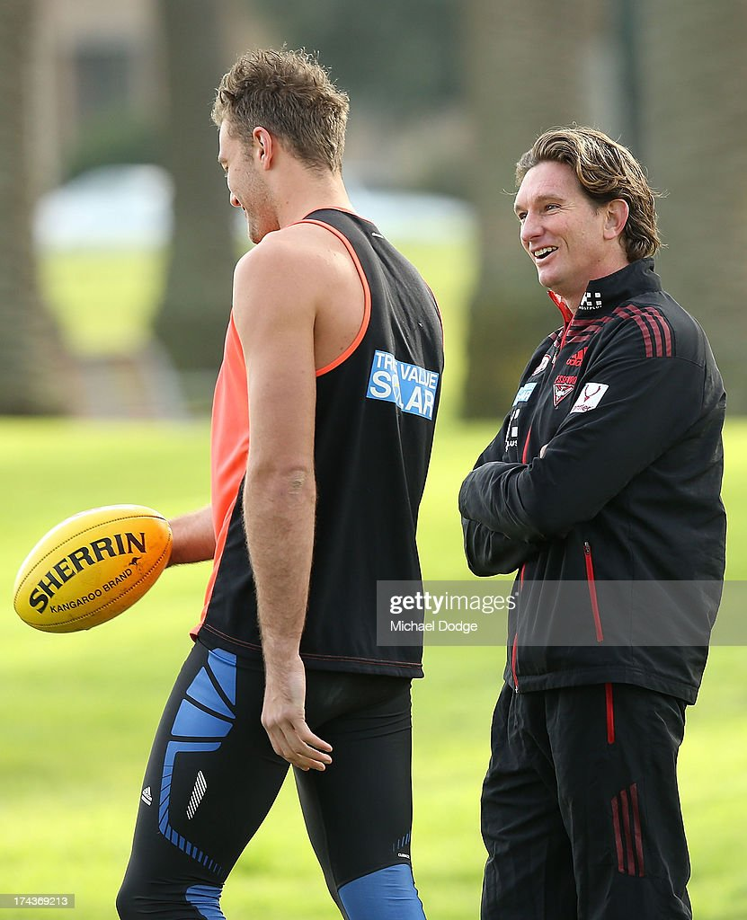Bombers coach <a gi-track='captionPersonalityLinkClicked' href=/galleries/search?phrase=James+Hird&family=editorial&specificpeople=201975 ng-click='$event.stopPropagation()'>James Hird</a> reacts with Tom Bellchambers during an Essendon Bombers AFL recovery session at the St Kilda Sea Baths on July 25, 2013 in Melbourne, Australia.