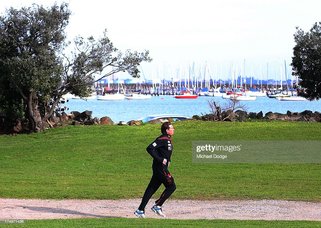 Bombers coach <a gi-track='captionPersonalityLinkClicked' href=/galleries/search?phrase=James+Hird&family=editorial&specificpeople=201975 ng-click='$event.stopPropagation()'>James Hird</a> runs to an Essendon Bombers AFL recovery session at the St Kilda Sea Baths on July 25, 2013 in Melbourne, Australia.