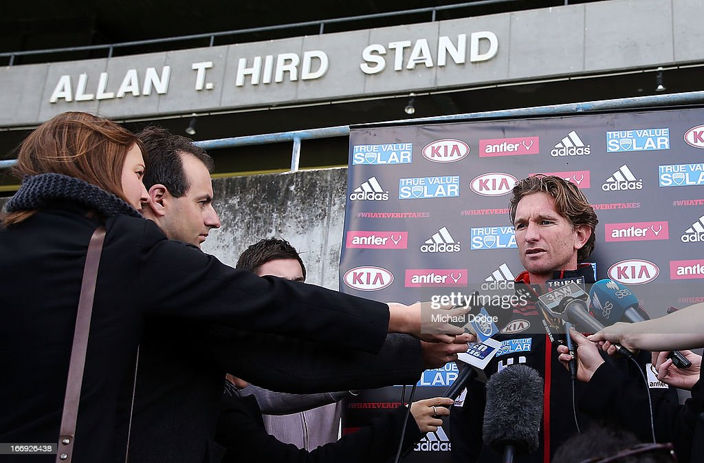 Bombers coach <a gi-track='captionPersonalityLinkClicked' href=/galleries/search?phrase=James+Hird&family=editorial&specificpeople=201975 ng-click='$event.stopPropagation()'>James Hird</a> speaks at his press conference in front of his grandfather's stand during an Essendon Bombers AFL training session at Windy Hill on April 19, 2013 in Melbourne, Australia.