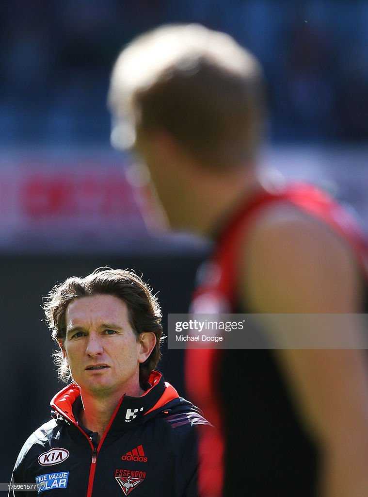 Bombers coach James Hird speaks to Dustin Fletcher during the round 20 AFL match between the Essendon Bombers and the West Coast Eagles at Etihad...