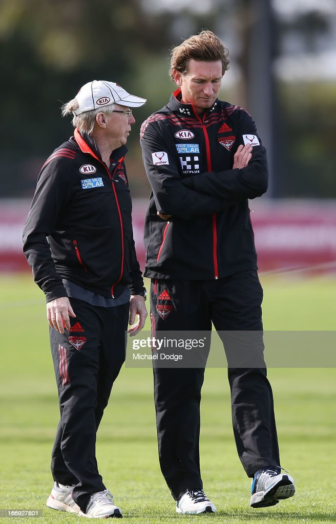 Bombers coach <a gi-track='captionPersonalityLinkClicked' href=/galleries/search?phrase=James+Hird&family=editorial&specificpeople=201975 ng-click='$event.stopPropagation()'>James Hird</a> (R) talks with Dr Bruce Reid during an Essendon Bombers AFL training session at Windy Hill on April 19, 2013 in Melbourne, Australia.