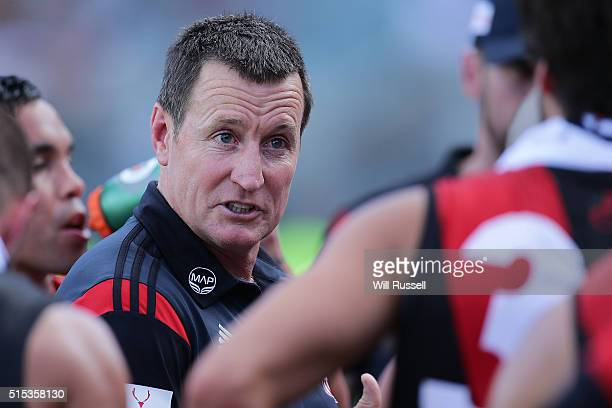 Bombers coach John Worsfold addresses the players at the quarter time break during the NAB Challenge AFL match between the West Coast Eagles and the...