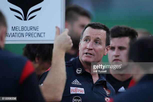 Bombers coach John Worsfold addresses the players at the threequarter time break during the NAB Challenge AFL match between the West Coast Eagles and...