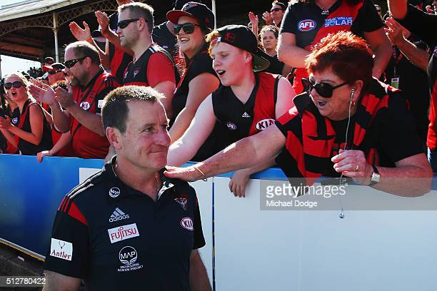 Bombers coach John Worsfold is greeted by fans after their win during the 2016 AFL NAB Challenge match between Carlton and Essendon at Ikon Park on...