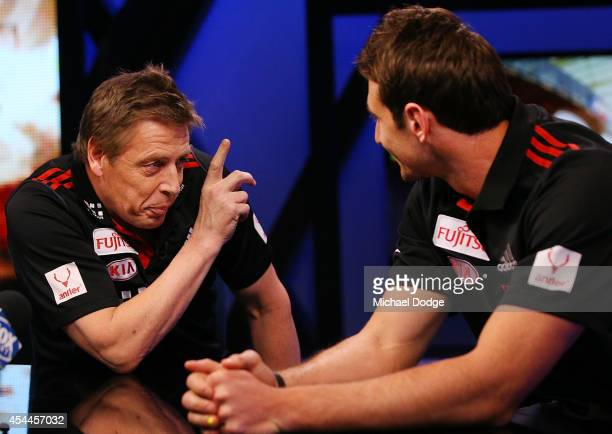 Bombers coach Mark Thompson gestures to Jobe Watson of the Bombers before to the media during the AFL Finals Series Launch at Fox Footy on September...