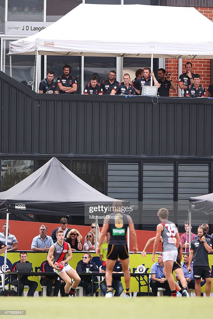 Bombers coach Mark Thompson looks on next to the whiteboard on the top deck during an AFL Practice Match between the Richmond Tigers and the Essendon Bombers at Punt Road Oval on March 7, 2014 in Melbourne, Australia.