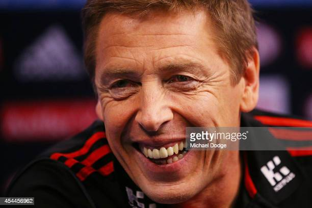 Bombers coach Mark Thompson reacts when speaking to the media during the AFL Finals Series Launch at Fox Footy on September 1 2014 in Melbourne...