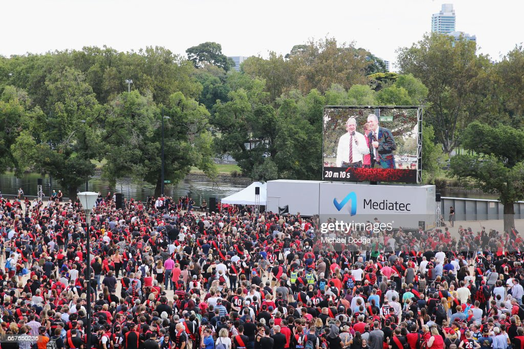 Bombers fans gather for the Walk To The MCG during the round one AFL match between the Essendon Bombers and the Hawthorn Hawks at Melbourne Cricket Ground on March 25, 2017 in Melbourne, Australia.