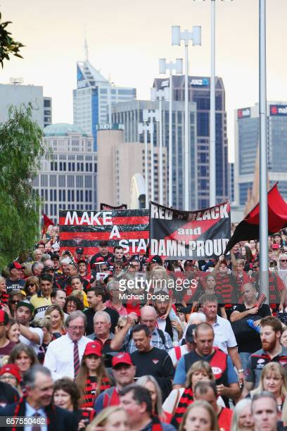 Bombers fans join the Walk To The MCG during the round one AFL match between the Essendon Bombers and the Hawthorn Hawks at Melbourne Cricket Ground...