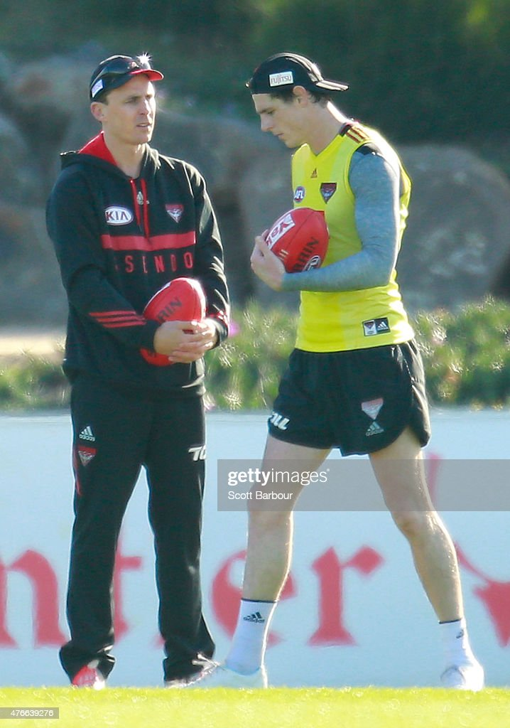 Bombers goalkicking coach Matthew Lloyd speaks with Jake Carlisle during an Essendon Bombers AFL training session at True Value Solar Centre on June...