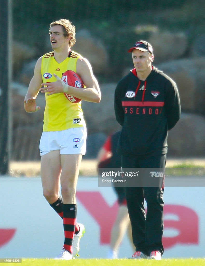Bombers goalkicking coach Matthew Lloyd speaks with Joe Daniher during an Essendon Bombers AFL training session at True Value Solar Centre on June 11...