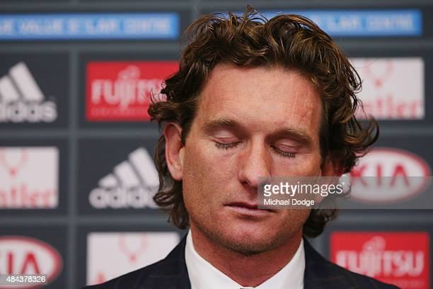Bombers head coach James Hird cries as he talks to the media following the announcement of his resignation as head coach at True Vaule Solar Centre...