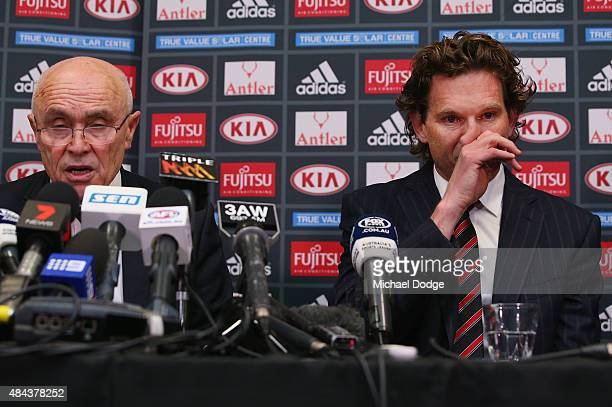 Bombers head coach James Hird cries next to Bombers Chairman Paul Little after he announced to the media of his resignation as head coach at True...
