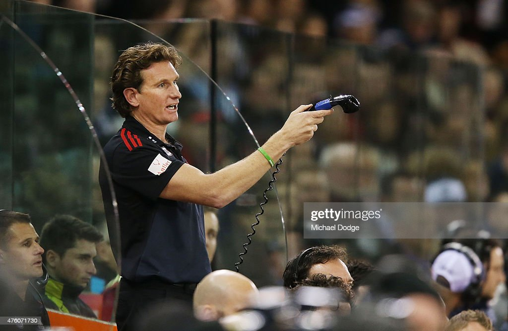 Bombers head coach James Hird reacts while coaching from the bench during the round 10 AFL match between the Essendon Bombers and the Geelong Cats at...