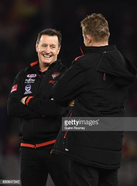 Bombers head coach John Worsfold talks to assistant Mark Neeld during the round 21 AFL match between the Essendon Bombers and the Adelaide Crows at...