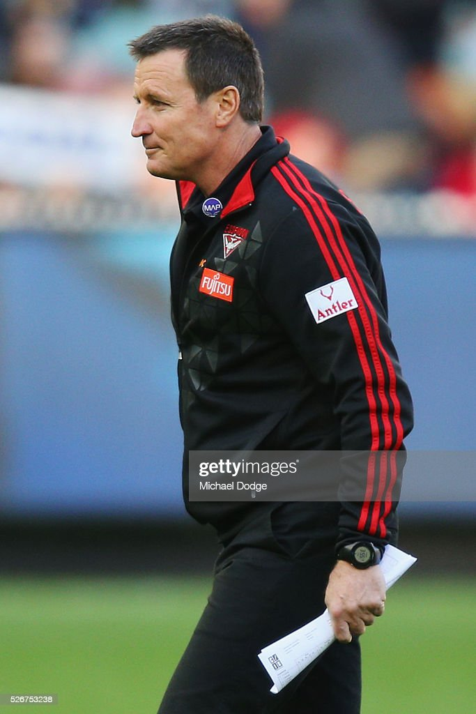 Bombers head coach John Worsfold walks off at at quarter time during the round six AFL match between the Carlton Blues and the Essendon Bombers at Melbourne Cricket Ground on May 1, 2016 in Melbourne, Australia.