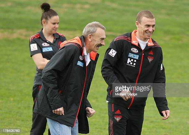 Bombers interim senior coach Simon Goodwin and CEO Ray Gunston react during an Essendon Bombers training session at Windy Hill on August 30 2013 in...