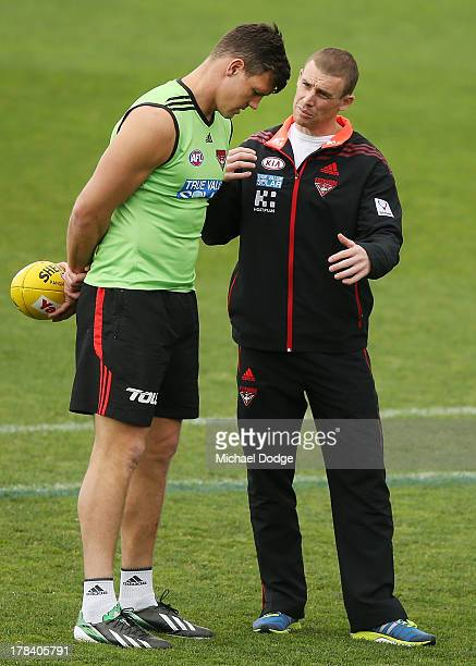 Bombers interim senior coach Simon Goodwin talks to David Hille during an Essendon Bombers training session at Windy Hill on August 30 2013 in...