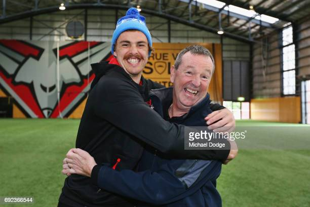 Bombers legend Neale Daniher gets a hug from nephew Joe Daniher of the Bombers after a cheque presentation to fight MND at the Essendon Football Club...